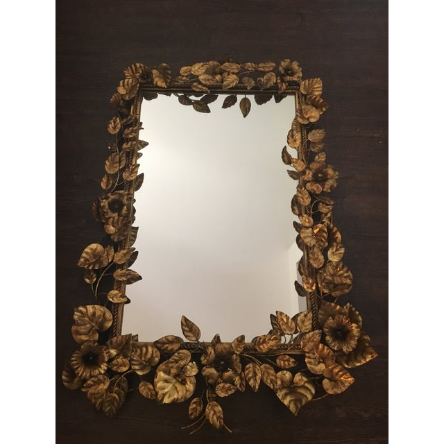 Crazy beautiful and rare mid century Italian gilded metal wall mirror. Beautiful floral and leaf design! Very Hollywood...