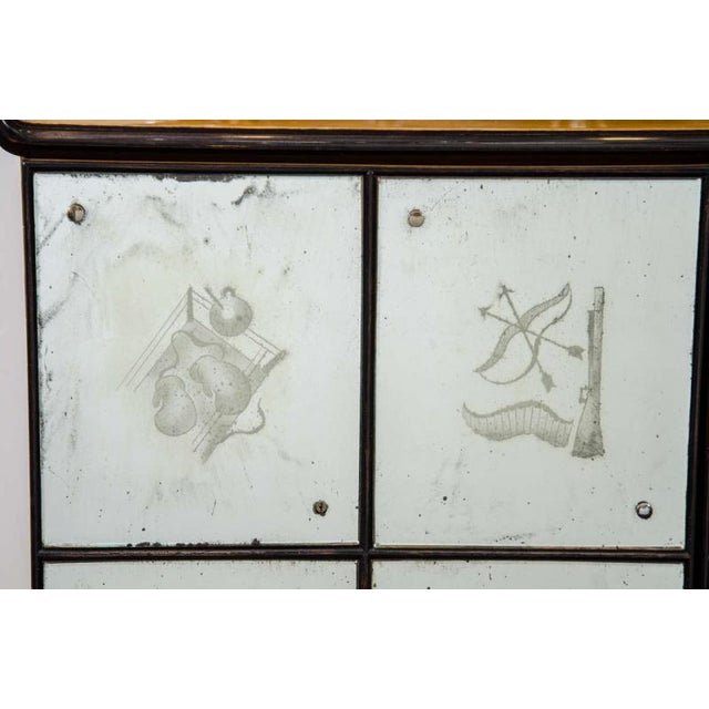 """A vintage bar cabinet with etched panel scenic exterior and an illuminated mirrored interior. Each tile has a """"sporting""""..."""