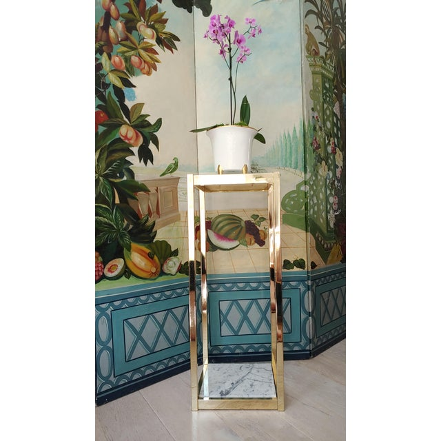 Pedestals are great for adding height and drama to a space. Vintage brass frame with Carrara marble tiers. Useful for...