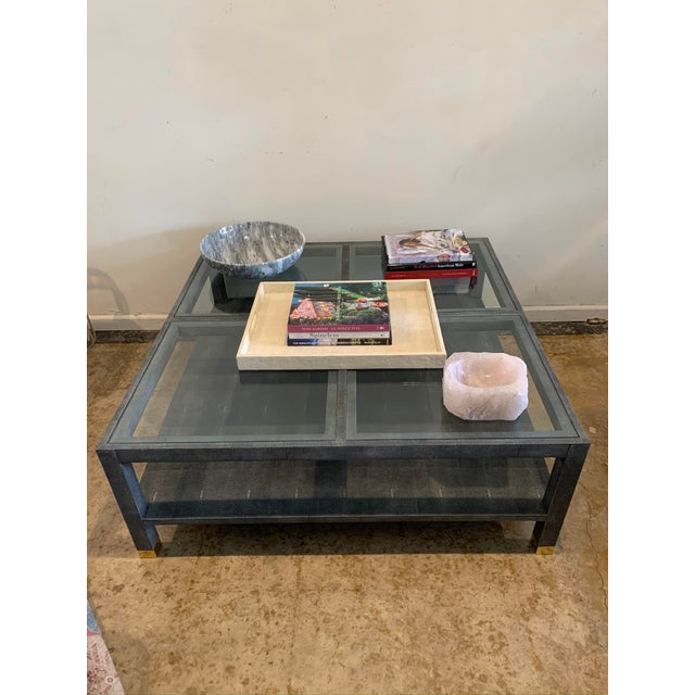 Generously sized faux shagreen coffee / cocktail table with glass top (four large glass tiles) and lower shelf. New from...