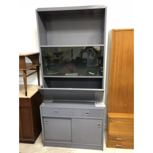 Stunning secretary with new high gloss grey lacquered finish, green felt lined drawers and smoked glass. Perfect for an...
