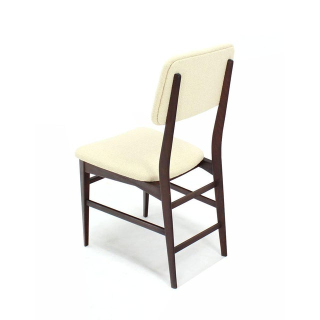 Set of four elegant tapered leg walnut Italian dining chairs. Very high quality craftmenship and design detail.