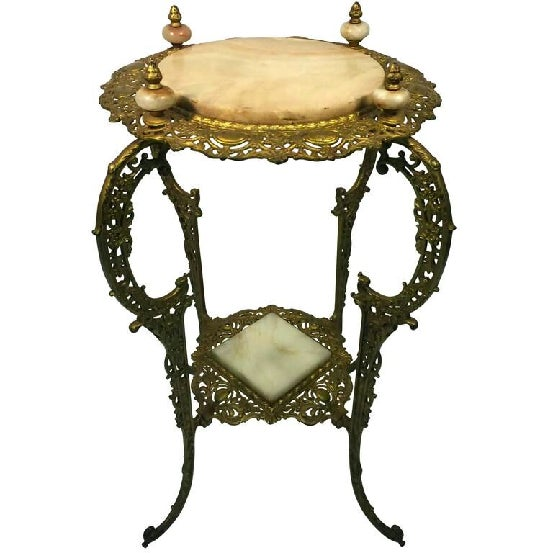 An amazing Art Nouveau two-tier onyx and gilded iron plant stand, circa 1910.