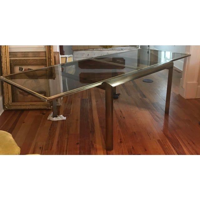 Mid-Century Modern smoked glass and heavy aged gold/brass frame dining table by DIA, Design Institute of America with the...