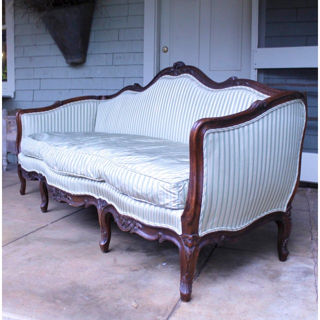 A very attractive carved Italian walnut sofa of understated Rococo form, very sturdy and comfortable. The frame is very...