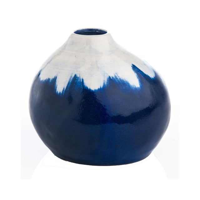 A collection of three hand made vases in interesting free form shape. All time favorite colors of blue and white...
