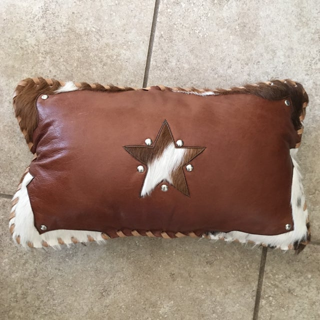 Beautiful handmade in Texas genuine leather lumbar pillow with Texas star in cowhide. Has some nice rivets and white and...