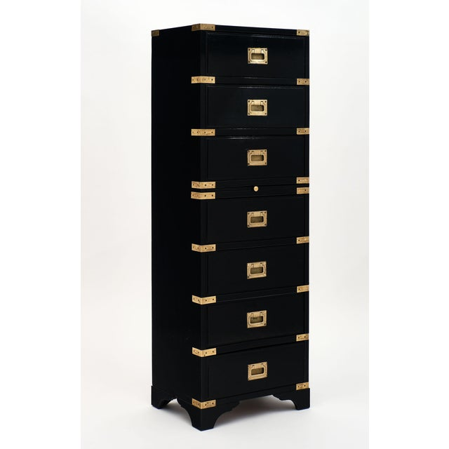 English Campaign style semainier made of cherry wood. This elegant cabinet features seven dovetailed drawers with original...