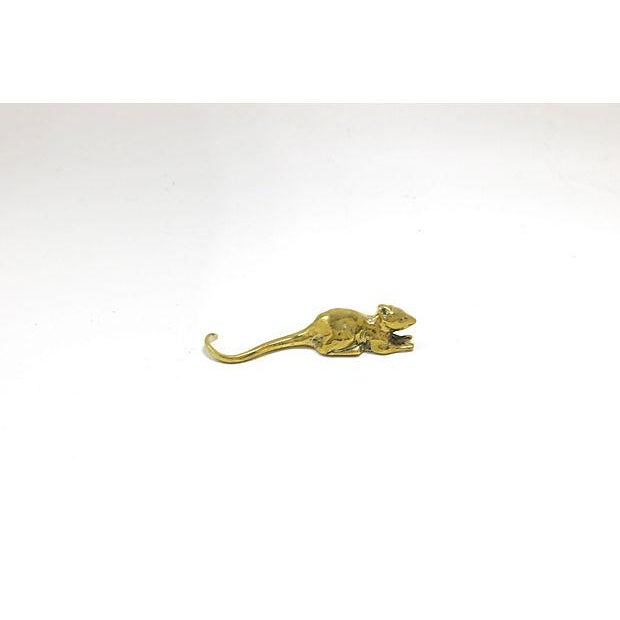 Antique English sold brass figural mouse paper weight. No maker's mark. Light wear.