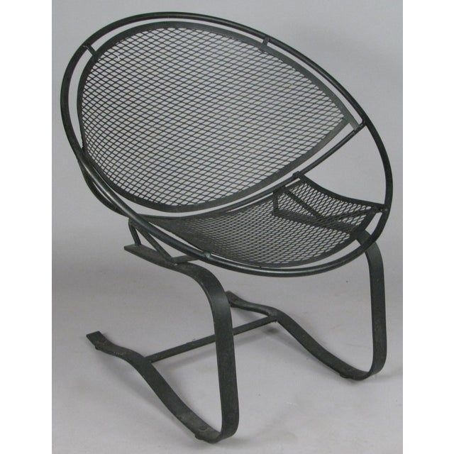 A wonderful pair of wrought iron Radar collection lounge chairs, with spring bases, designed in 1950 by Mauricio...