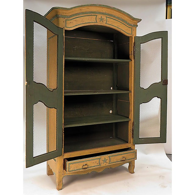 A well scaled armoire/bookcase or cabinet made in the countryside of Italy during the first part of the 19th century....