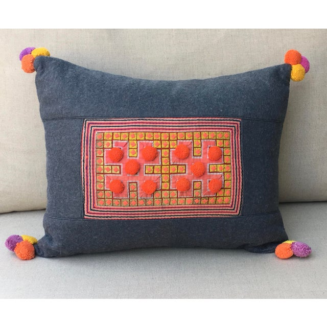 Vivid Applique Hmong Textile Pillow on gray felt with pom pom from Thailand. The fabric is from Thailand and the pillow is...