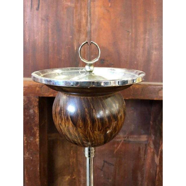 Art Deco ashtray stand. The item is metal with a painted wood finish and has a weighted base. Stand also tilts back and...