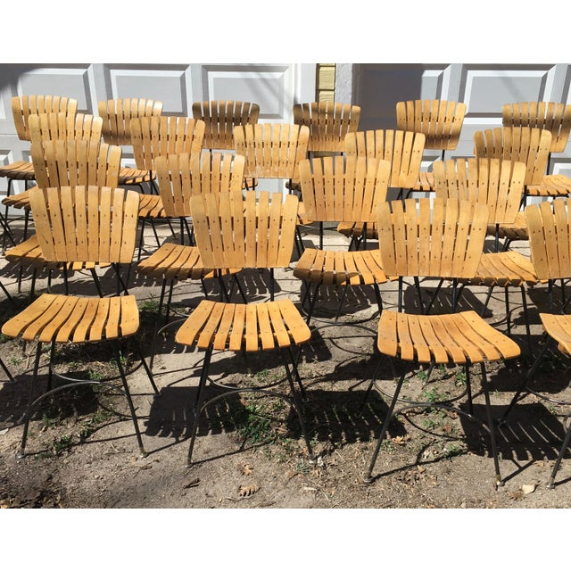 It isn't everyday that you find this model of Arthur Umanoff slatted wood and iron modernist chair (with the arched half...