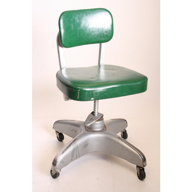 Vintage Industrial Chair. Solid steel Modernist base. Frame is in great shape. The green vinyl is original however has...