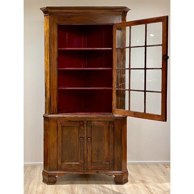 Federal fruitwood Chippendale corner cabinet. This provincial example has great storage and nice old patina. United States...