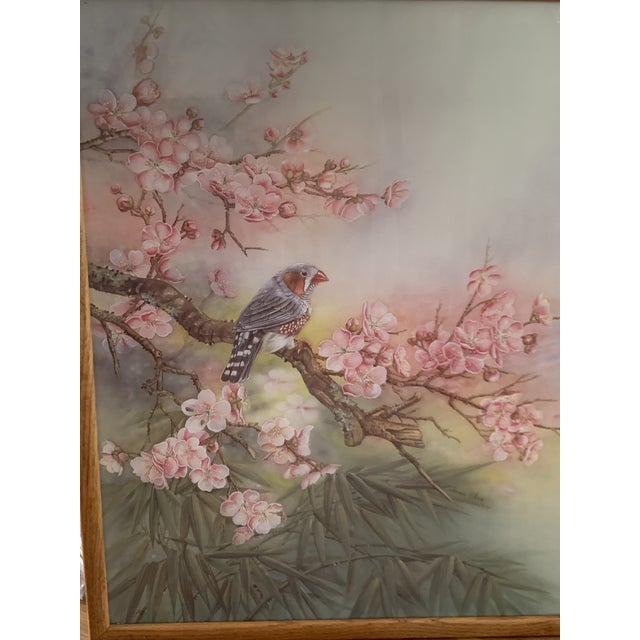Large vintage cherry blossom and bird wall art framed in a simple oak wood frame. Signed. I'm not certain as to what...