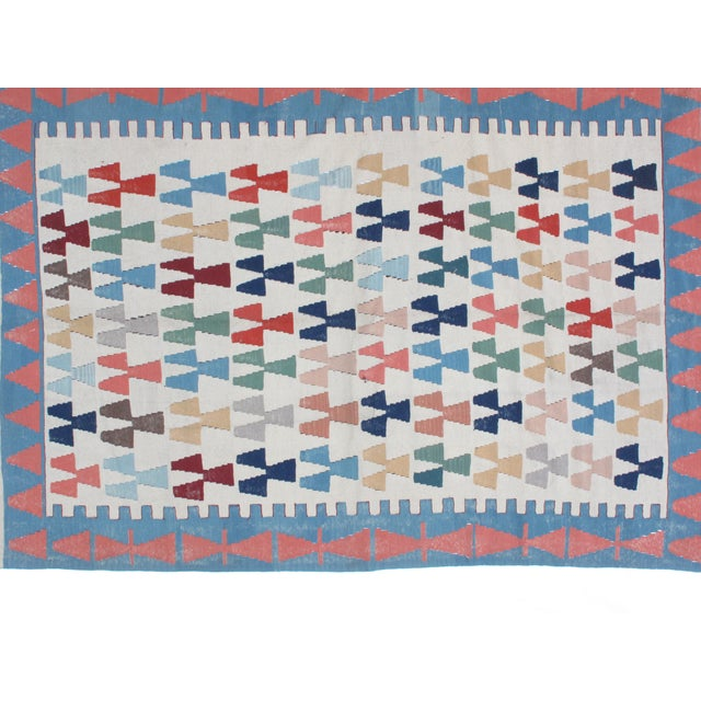 Crafted of plush wool, this vintage, hand-woven Anatolian Kilim is in mint condition.