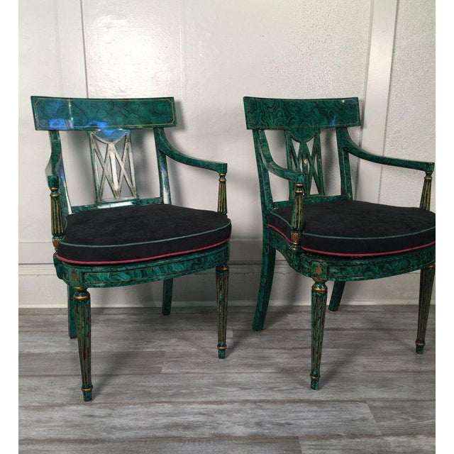 A pair of Maitland Smith armchairs in a malachite painted finish. The classic Napoleonic form with highly detailed...