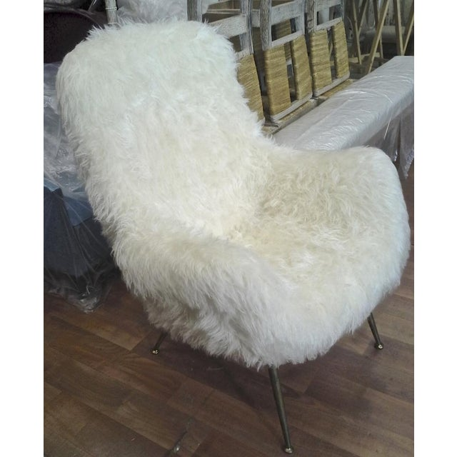 Fritz Neth pair of comfy large lounge chairs newly covered in in sheep skin fur.