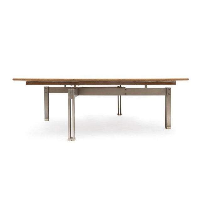 Square burl wood veneer top coated in epoxy resin stainless steel base on four legs. Denmark, circa 1960s. Measures: L 90...