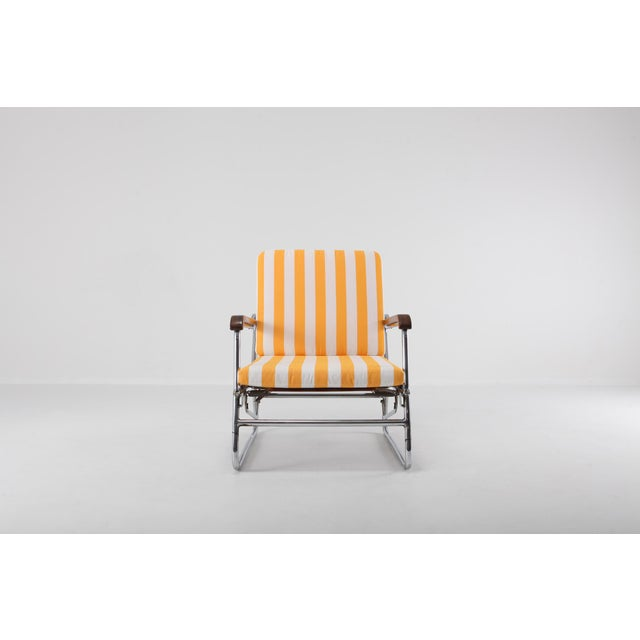 Bauhaus style chaise longue in tubular chromed steel, mahogany armrests and newly upholstered yellow and white striped...