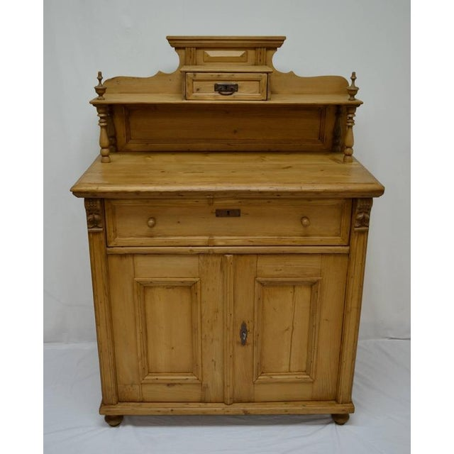This is a most attractive pine chiffonier with beautiful proportions. The upper gallery features crown molding above a...