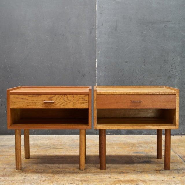 Hans J. Wegner for RY Mobler of Denmark. Oak and teak side table cabinets.