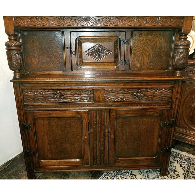 Presenting a really nice example of an early 20th century English oak Renaissance Revival cabinet, all hand carved....