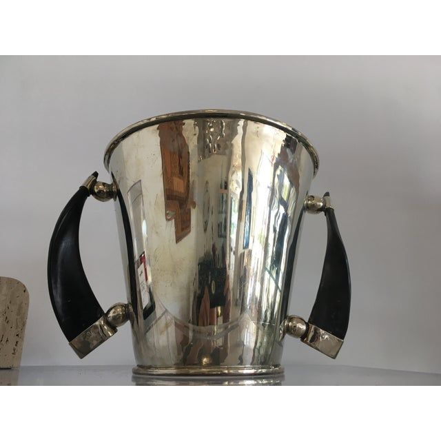 Bold and masculine silver plate ice bucket with horn handles-- made in Argentina. We have the companion pitcher in another...
