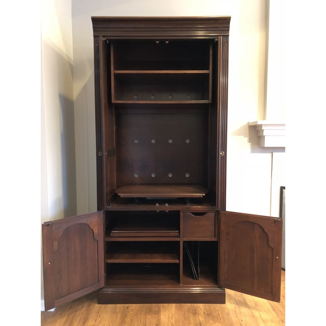 """Solid Cherry construction. Accommodates 30"""" wide TV, turntable, multiple stereo components, records and CDs/DVDs. TV shelf..."""