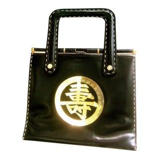 1970s Sleek Asian Emblem Black Leather Handbag For Sale