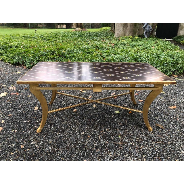 Transitional inlaid wood coffee table by Amy Howard. The table has a banded diamond design with an exotic wood background....