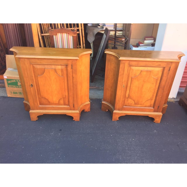 Pair of Baker Furniture Side Cabinets. In excellent condition. These only have one key. I believe these to be cherry wood....