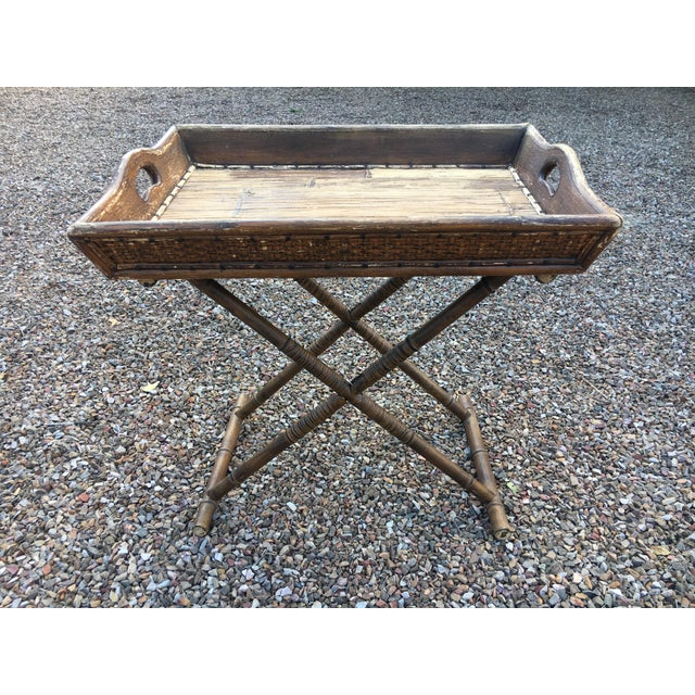 Vintage cane tray with fildong base. Features nailhead trim.