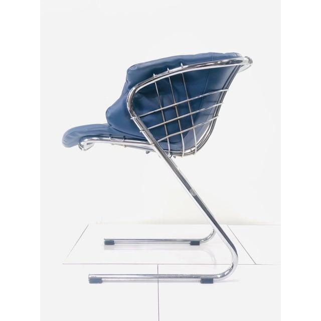 superb in bleu- these handsome futuristic chairs were designed by Gastone Rinaldi for his Fathers furniture company Rima....