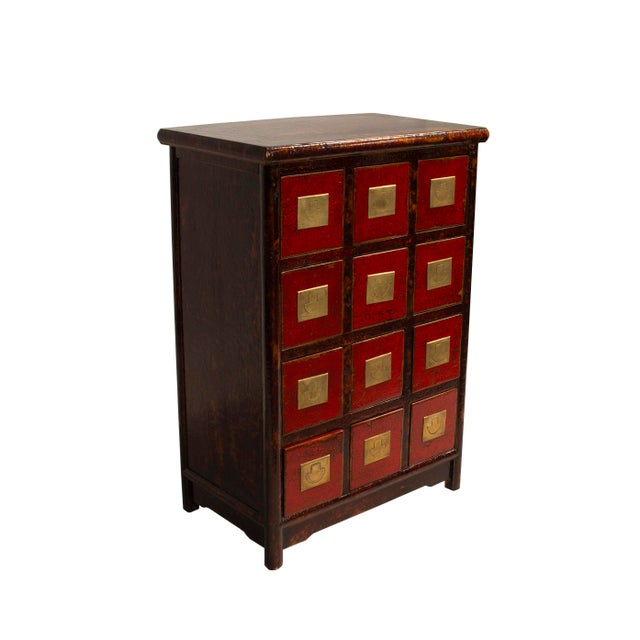 This Chinese medicine cabinet is made from reclaimed wood and is a copy of a traditional Chinese medicine cabinet. It has...