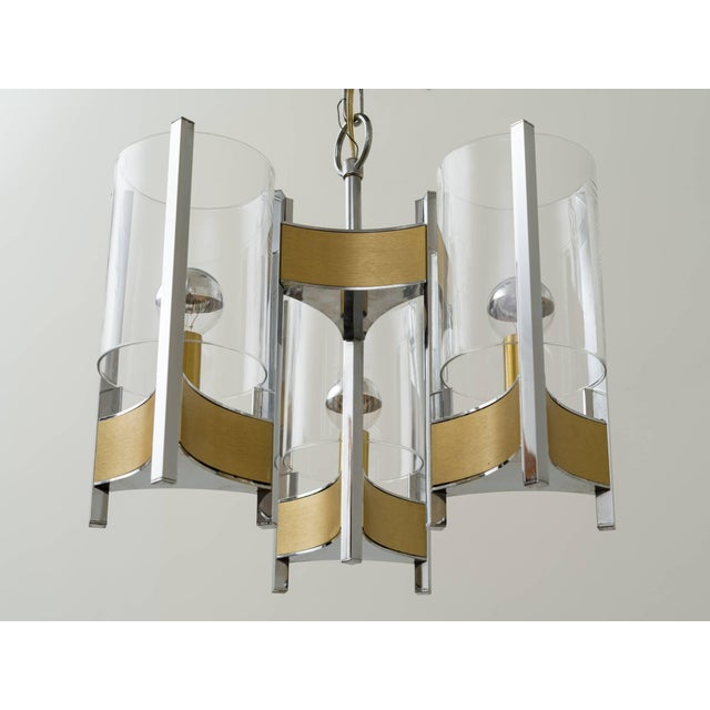 Gaetano Sciolari brushed brass and chrome chandelier with glass hurricane shades, illuminated with partial mercury glass...