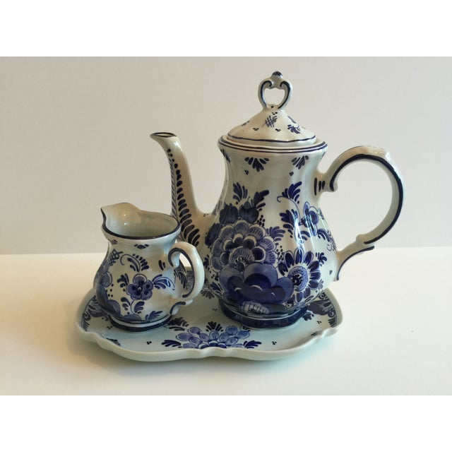 "Charming blue and white coffee set by Delft, Holland. Looks to be hand-painted. Tray is 71-2""x4"". Below measurement is for..."