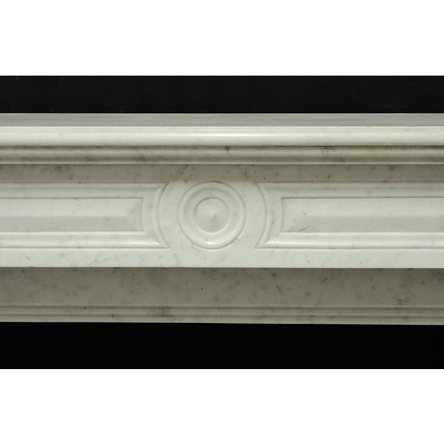 Small and elegant white marble Louis XVI fireplace mantel, 19th century, France. Opening measurements: 30.3 x 31.8 inch...
