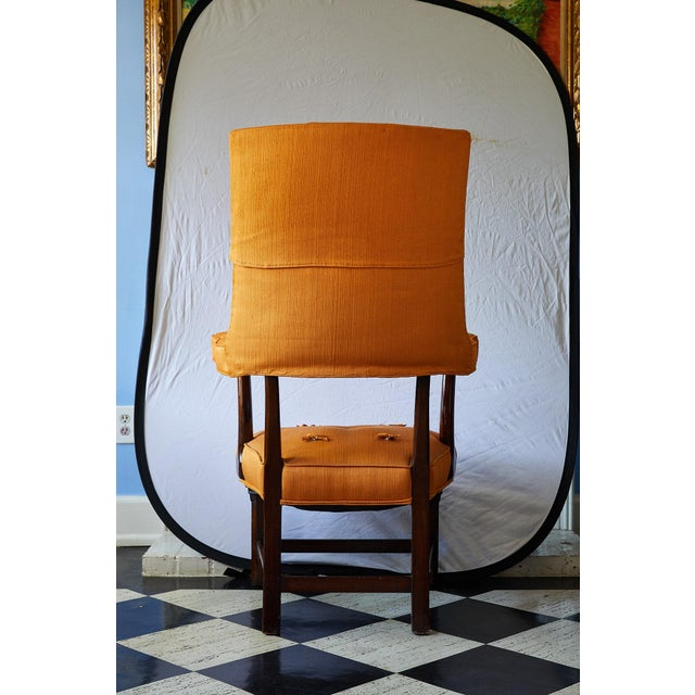 Charming and unique early 20th Century arm chair made of solid mahogany and having an upholstered back, arms, and seat in...