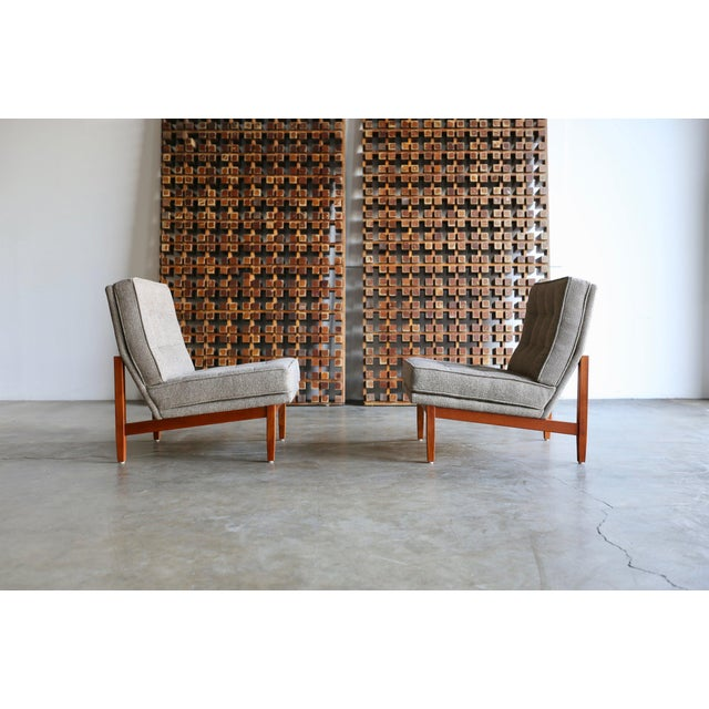 Pair of tufted slipper lounge chairs by Florence Knoll. Manufactured by Knoll, circa 1955. Solid teak wood frames. Freshly...