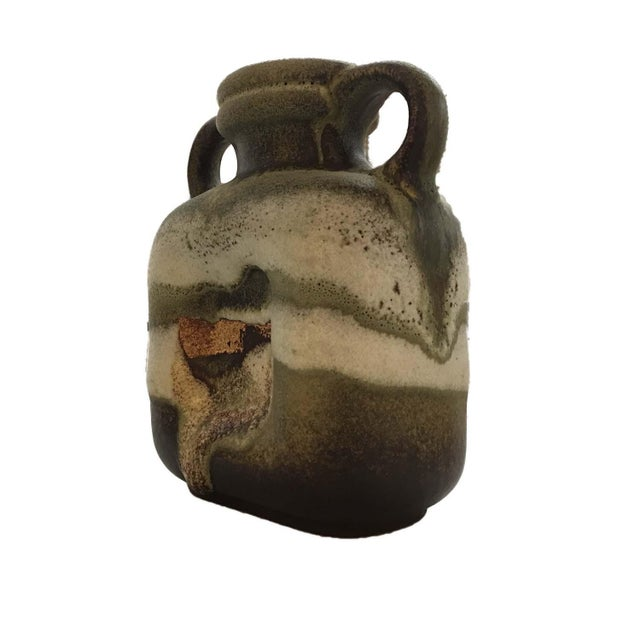 This is an interesting vintage, double-handled square jug in striated organic greens and creams with a terra cotta accent....