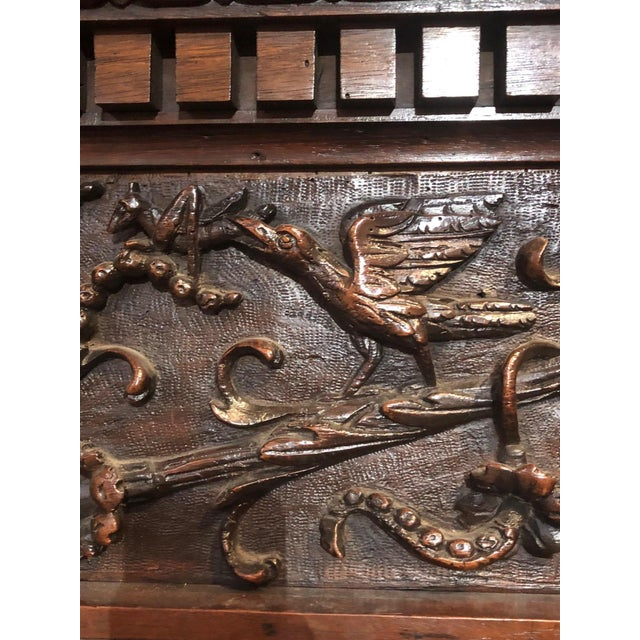 This massive, intricately carved mantel really tells a story! It is adorned with an array of detail, organic carvings and...