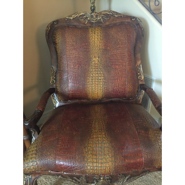This beautiful accent chair features rich, embossed leather with crocodile pattern and is an artful centrepiece in any...