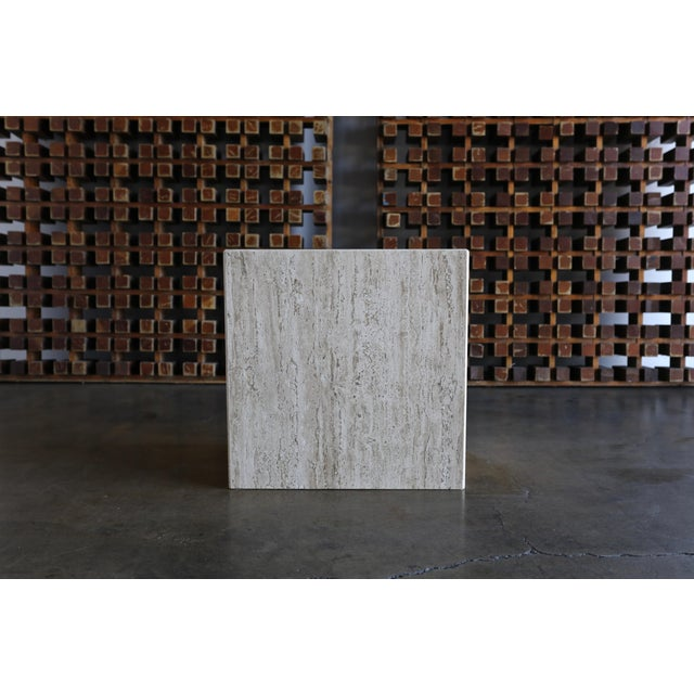 Travertine pedestal or side table, circa 1975.