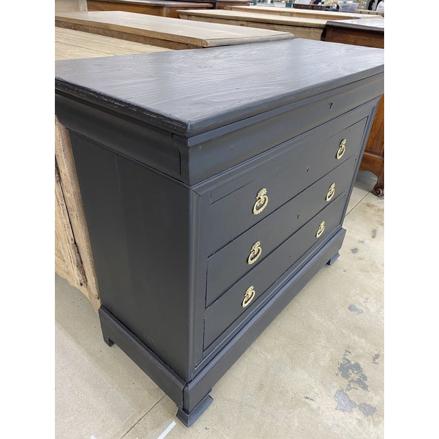 19th. C. French Empire commode. Painted in a black finish with polished bronze hardware. Consist of a locking top drawer...