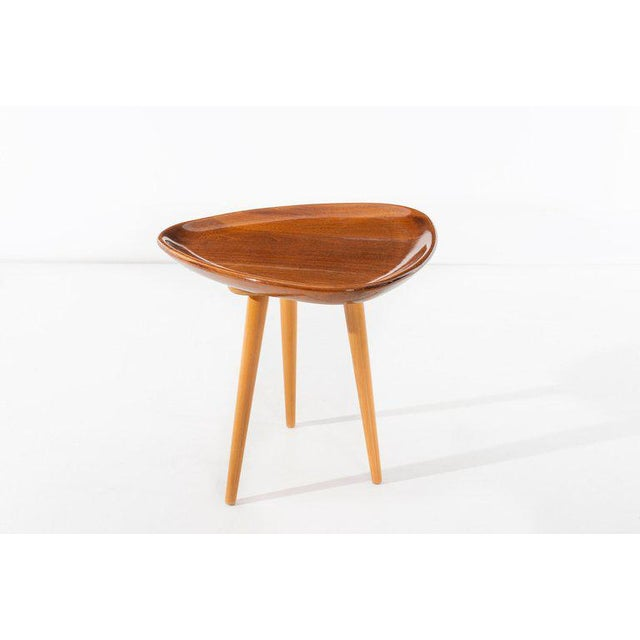 Robin Day (1915 - 2010) Sculptural occasional stool in guitar-pick form, raised on three tapered dowel legs. From a...