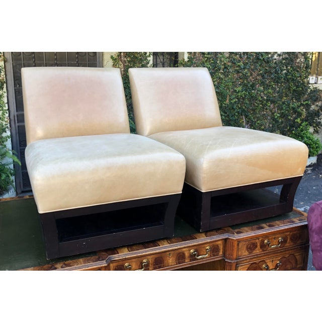 Pair of Donghia Open Villa Leather Swivel Slipper Chairs Note: In Los Angeles, we are not receiving walk-in shoppers but...
