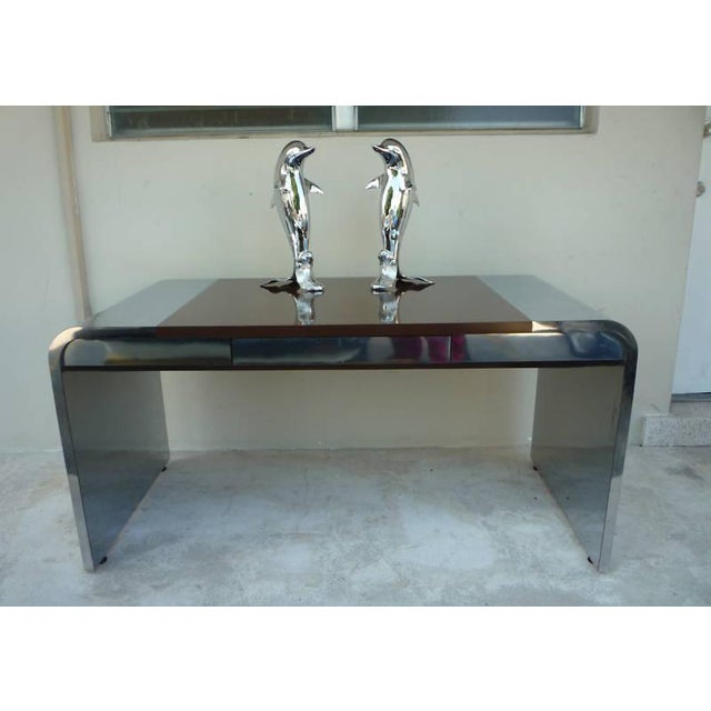Pair of incredible 70's chromed brass swimming dolphins standing 29 inches high each, in very good condition. Great as is...